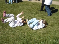 Christine & Maura rolling in grass